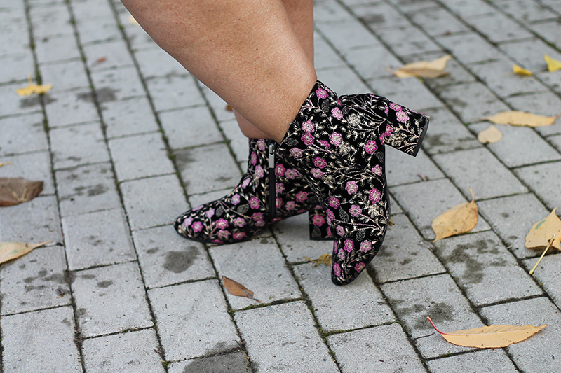 Plus Size woman wearing floral ankle boots