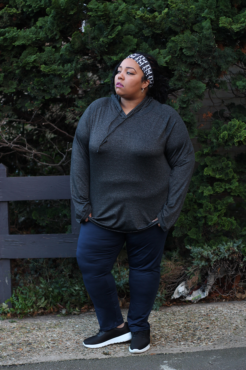 Plus Size woman wearing activewear from Pretty Little Thing